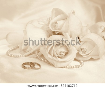 Wedding Rings And Roses As Background In Sepia Toned Retro Style