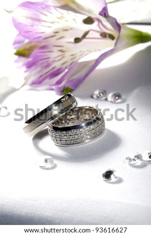 Wedding rings and the flower - stock photo