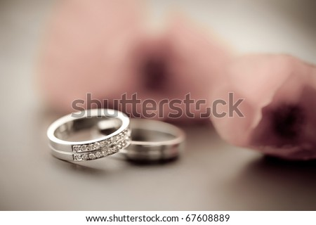 Wedding rings and tullips - stock photo