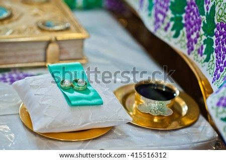 wedding rings at church and communion - stock photo