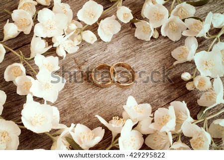 Wedding rings in a middle of white summer flowers