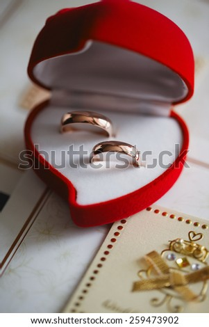 Wedding rings in a red heart box - stock photo