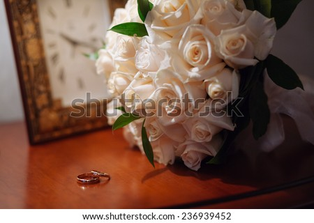 wedding rings in box on a nightstand with lamp - stock photo