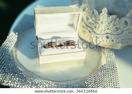 wedding rings in white wedding box on ceremony place - stock photo