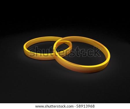 wedding rings isolated on black background - stock photo