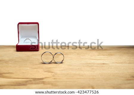 wedding rings on a wooden table - stock photo