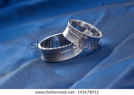 Wedding rings on satin
