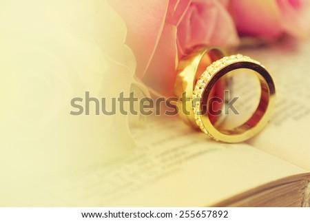 Wedding rings on the Bible. - stock photo