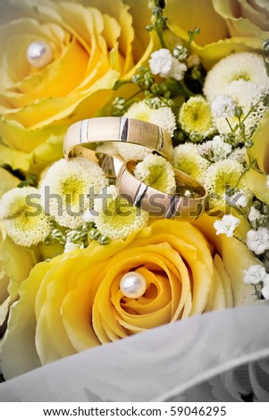 wedding rings on the flowers - stock photo