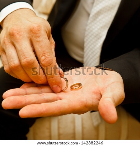 Wedding rings on the palm of the bride