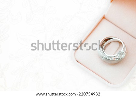 wedding rings on wedding dress, texture - stock photo