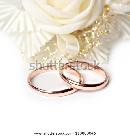 Wedding rings on white background - stock photo