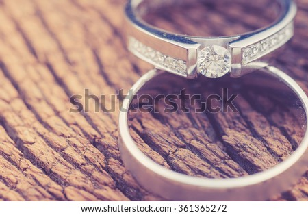 wedding rings on wood,vintage color toned image