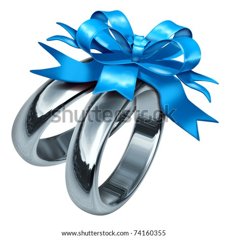 wedding rings tied with a blue bow symbolizing love and life partnership also representing marital celebration with a gift of silver and titanium jewelry. - stock photo
