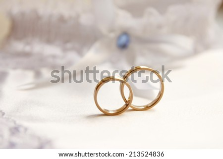 Wedding rings with stones on silk - stock photo