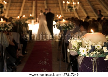 Wedding Service in Chapel.  FOCUS ON THE FLOWER BOUQUET - stock photo