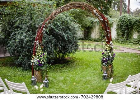 Wedding set garden wedding ceremony wedding stock photo image wedding set up in a garden wedding ceremony wedding decorationswedding archway with junglespirit Images