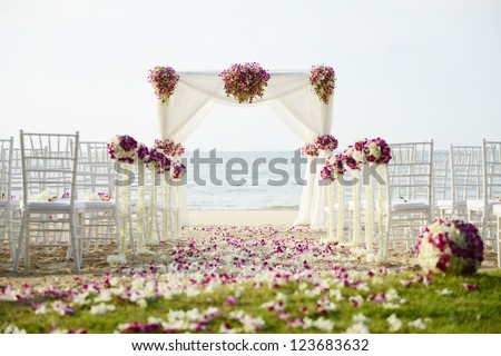 Wedding setting on the beach. - stock photo