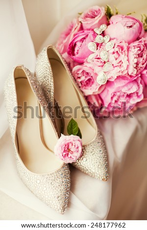 wedding shoes and bouquet of peony - stock photo