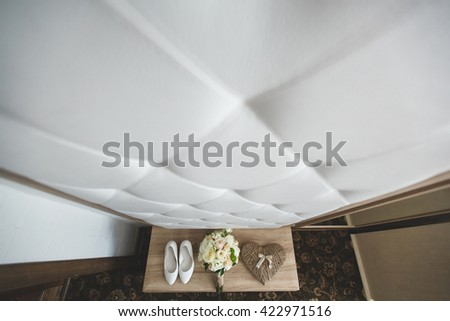 Wedding shoes. Bouquet. The pillow with the rings.