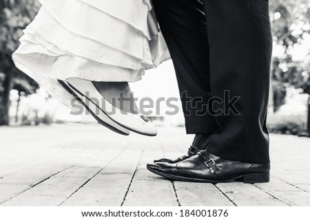 wedding shoes in a standing bride and groom. retro vintage photo - stock photo