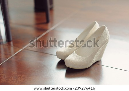 wedding shoes on kitchen floor