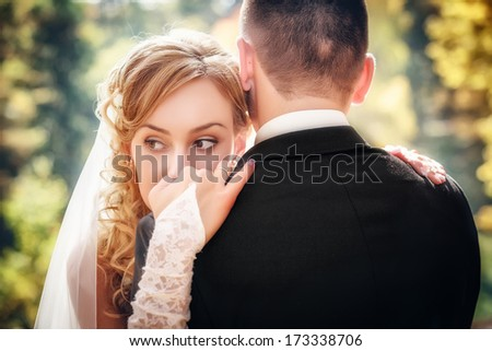 Wedding shot of bride and groom in park  - stock photo