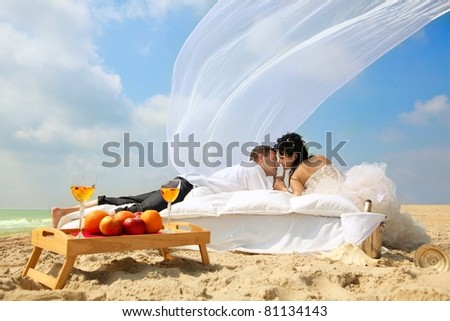 Wedding shot of sexy passion between bride and groom - stock photo