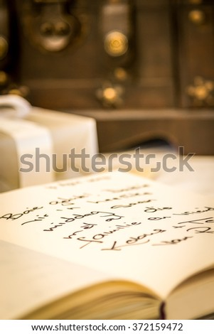 "Wedding signature book (wording is in Afrikaans, it reads: ""Best of luck for your day together with your family and friends."""
