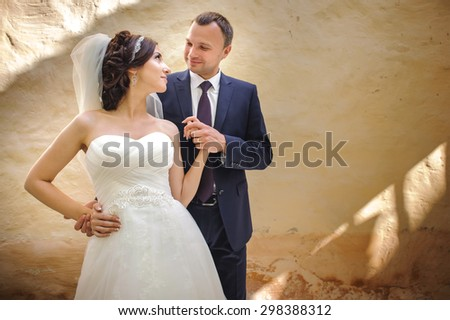 Wedding summer couple together posing at street. - stock photo
