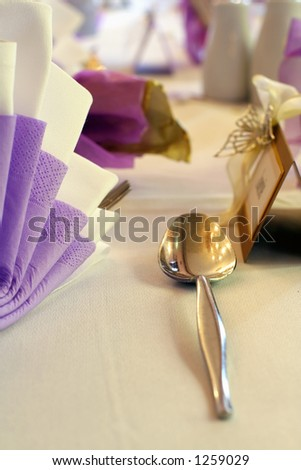 Wedding table and silver spoon - stock photo