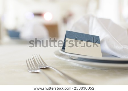 wedding table appointments. closeup forks and plates with invitation - stock photo