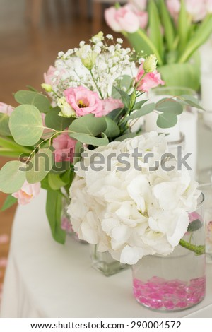 Wedding Table Decoration. Table set for a wedding dinner. Beautiful flowers on table in wedding day - stock photo