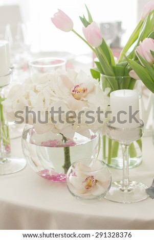 Wedding Table Decoration. Table set for a wedding dinner in white