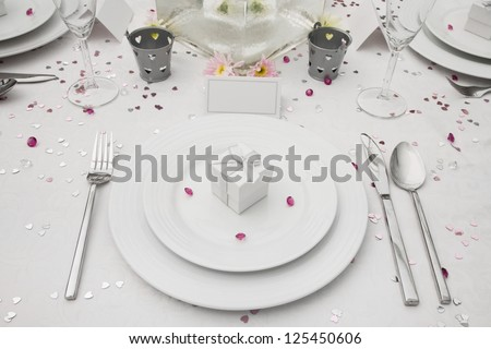 Wedding Table display with wedding Favor box on a bone china plate - stock photo