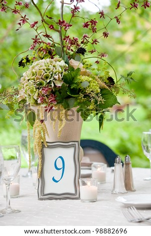 Wedding table set for fine dining or other catered event - stock photo