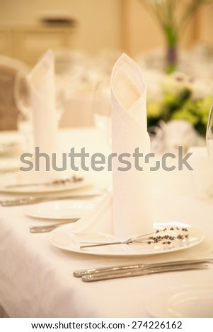 Wedding table setting. Table set for an event party or wedding reception. - stock photo