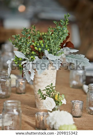 Wedding table setting with nature theme of rustic wildflowers  - stock photo