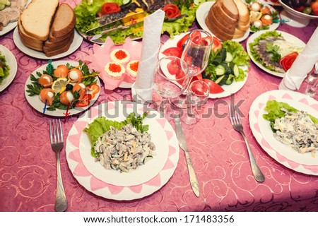 Wedding table. Table set for wedding dinner. wedding party favors on plate at reception - stock photo