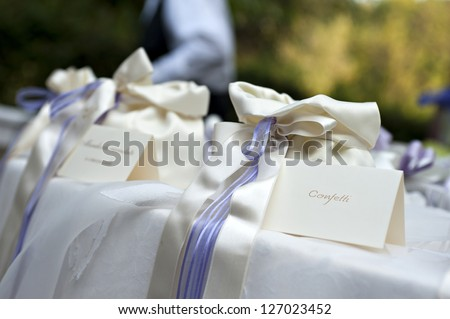 wedding table with bags of confetti - stock photo