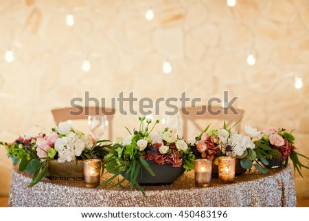 wedding table with flowers and golden decor - stock photo