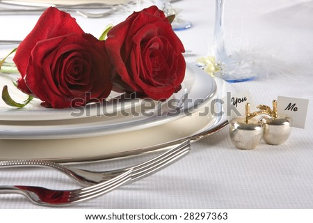 Wedding table with roses and name cards - stock photo