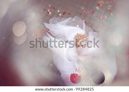 wedding theme. beautiful bride with a bouquet of flowers on top form