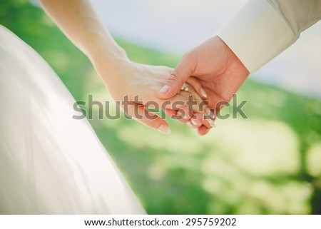 wedding theme, holding hands newlyweds - stock photo