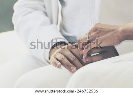 wedding theme, holding hands with love mood and tone. - stock photo