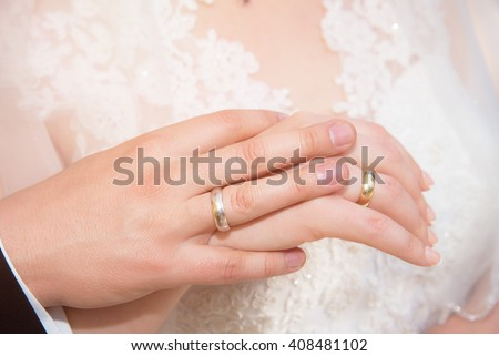 wedding theme, man and woman holding hands  - stock photo