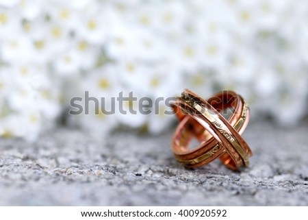 Wedding. Wedding card. Wedding. wedding flowers. Wedding rings and spring flowers / Wedding Rings / Wedding Rings. Wedding still life. Wedding card with wedding rings. Wedding rings on stone.  - stock photo