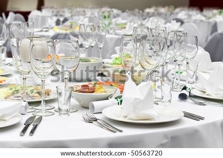 Wedding white reception place ready for guests. Elegant banquet tables prepared for a conference or a party. - stock photo