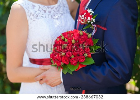 weddings bouquet in the bride and groom hands - stock photo