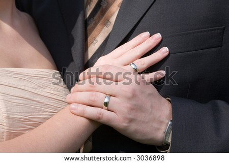 Weddings rings and holding hands - stock photo